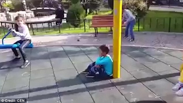 Shocking video shows Turkish men mocking Syrian boy in a playground and telling him a bomber is about to launch an airstrike right above him