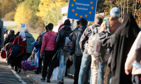 German migrant bill to reach £13 BILLION for those who have arrived in last 18 months