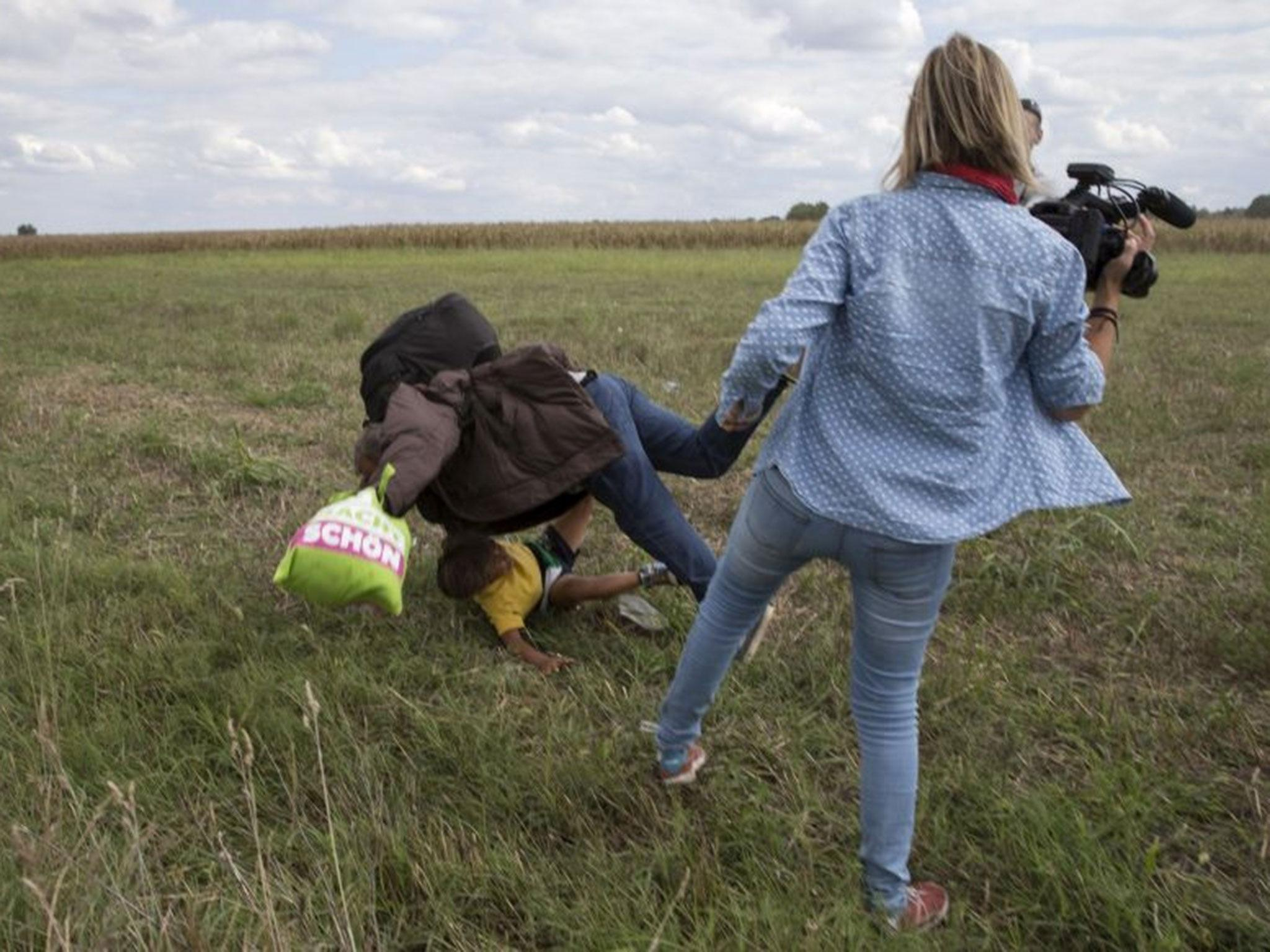 Hungarian filmed tripping up fleeing refugees is convicted