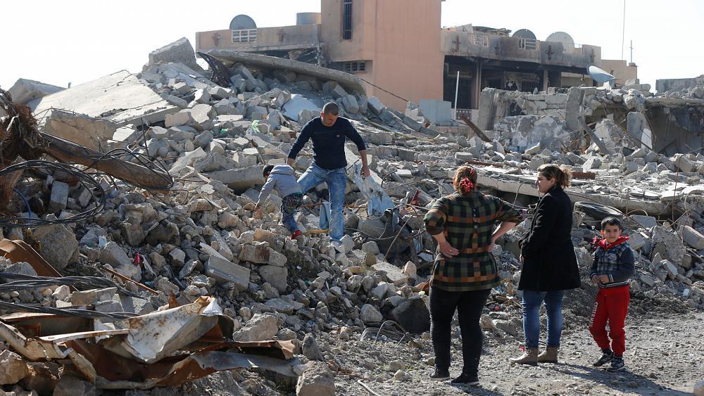 IRAQ: CHRISTIANS FIND HOMETOWN IN RUINS