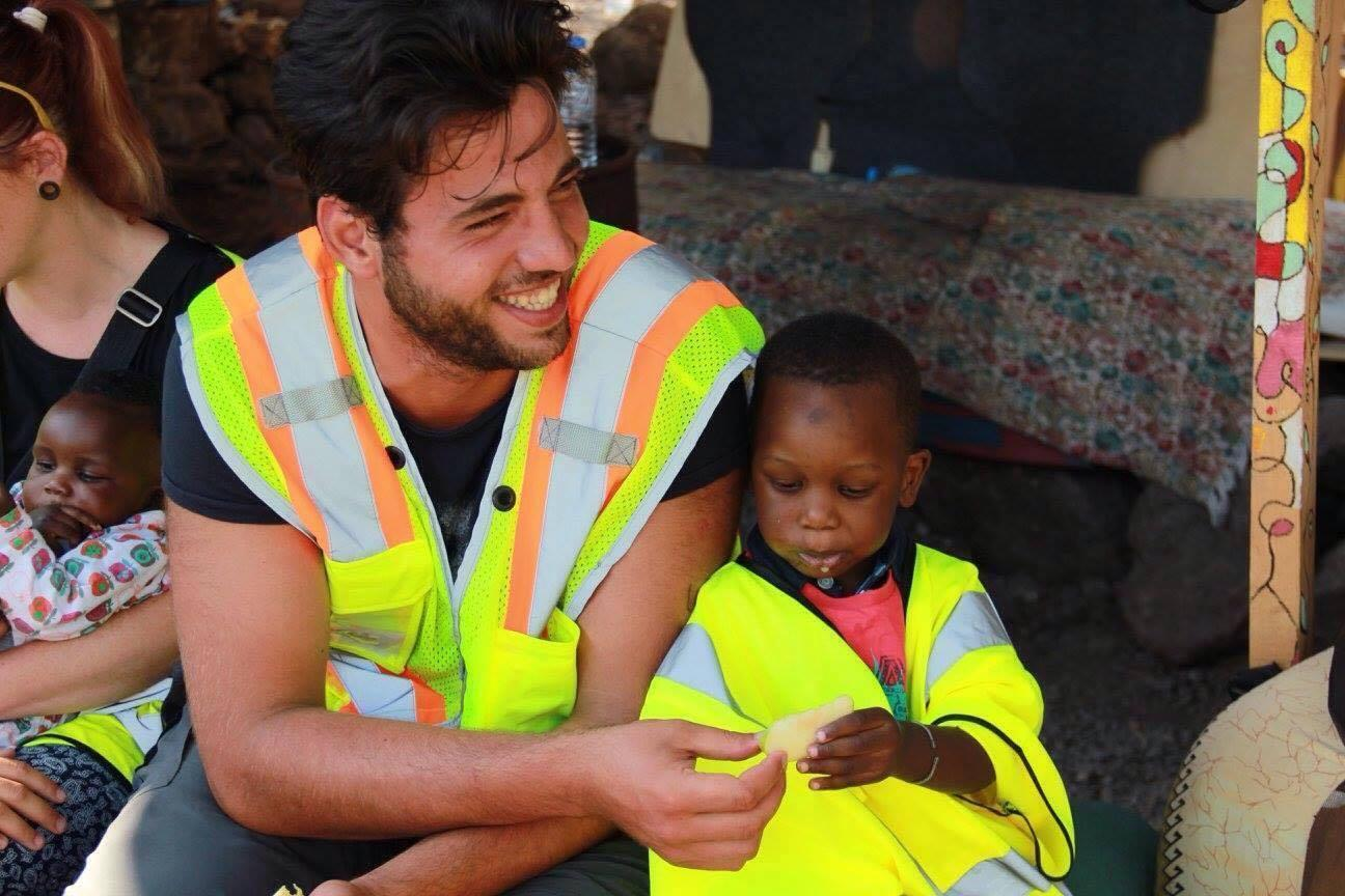Injured Syrian who swam to Greece sets up charity to help other refugees