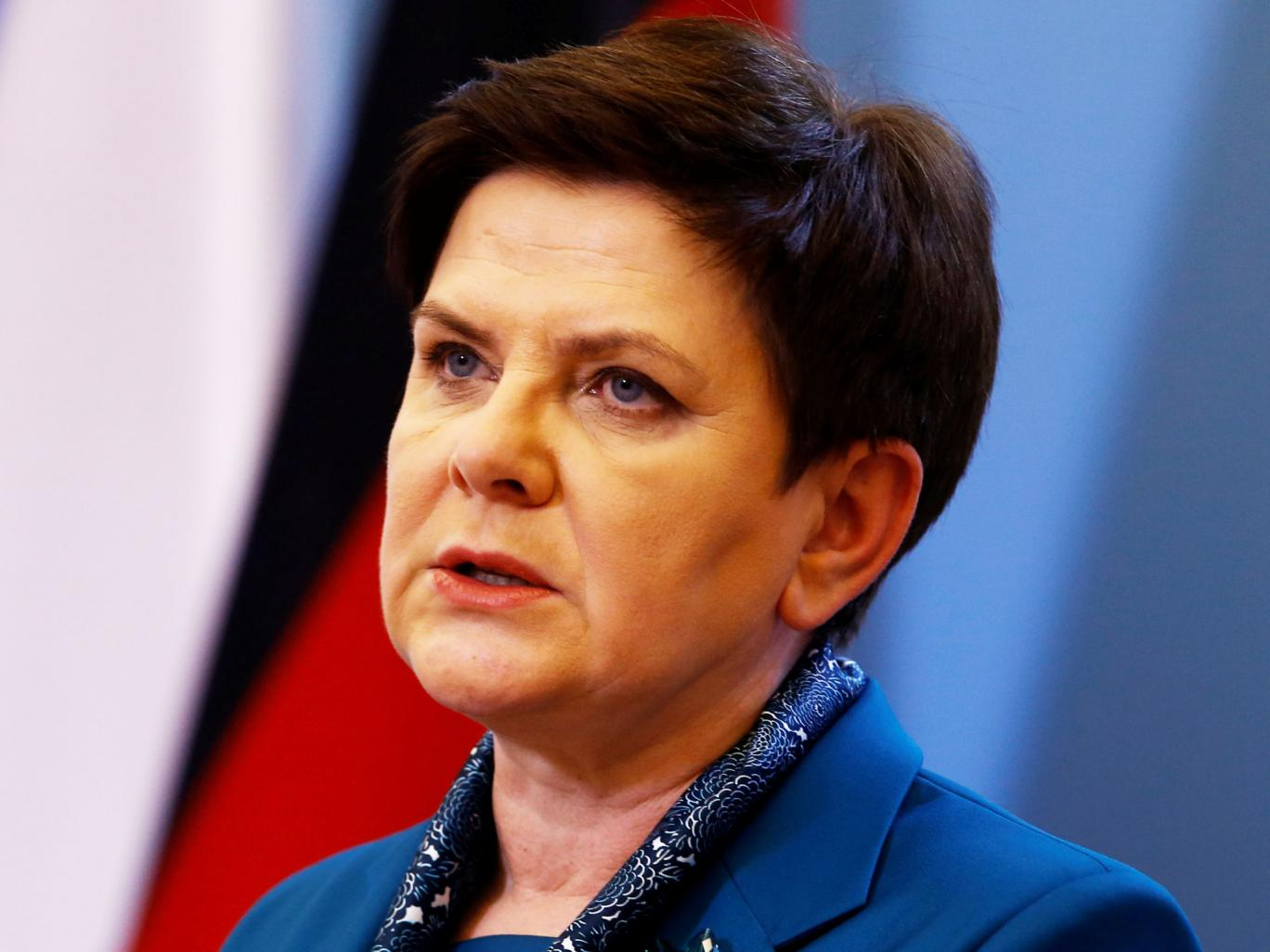 Poland's Prime Minister says country will accept no refugees as EU threatens legal action over quotas