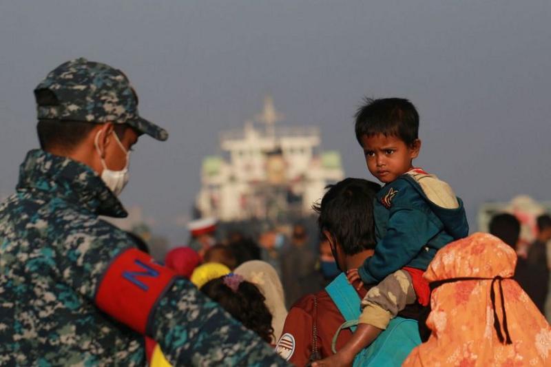 Myanmar police arrest nearly 100 Rohingya in raid on house