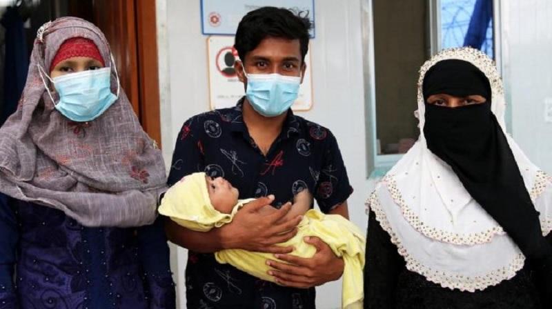 Displaced Rohingya navigate new parenthood in Bangladesh